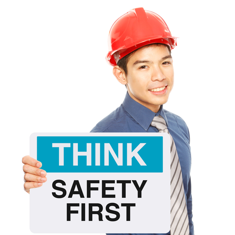 young worker with sign, Safety First © Arnel Manalang | Dreamstime.com